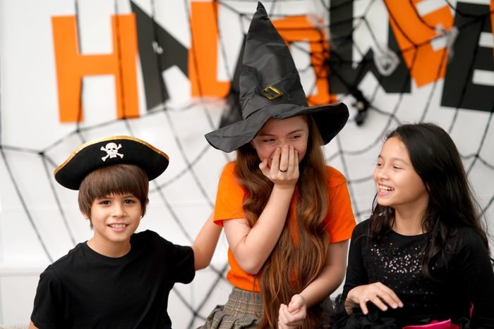 kids laughing playing truth or date at halloween party