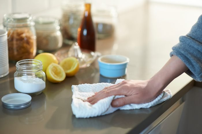 Cleaning kitchen with natural cleaning products.
