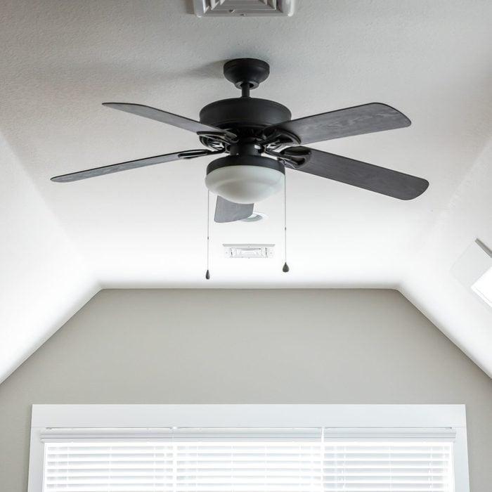 ceiling fan in bedroom of house