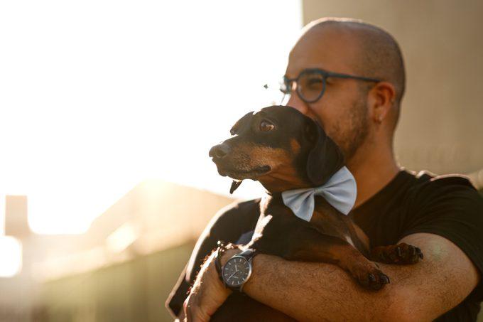 Man holding his dachshund