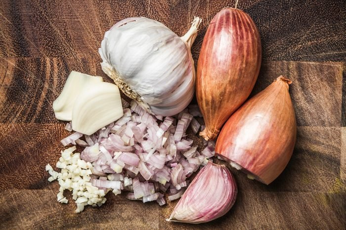 Ingredients for making green curry paste - onion, garlic