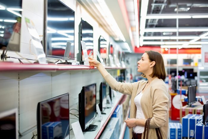woman shopping for a television