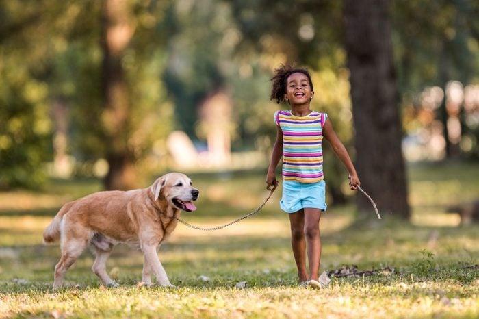 young girl with her labrador retriever