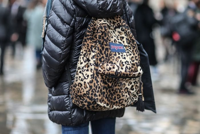 woman carrying jansport backpack