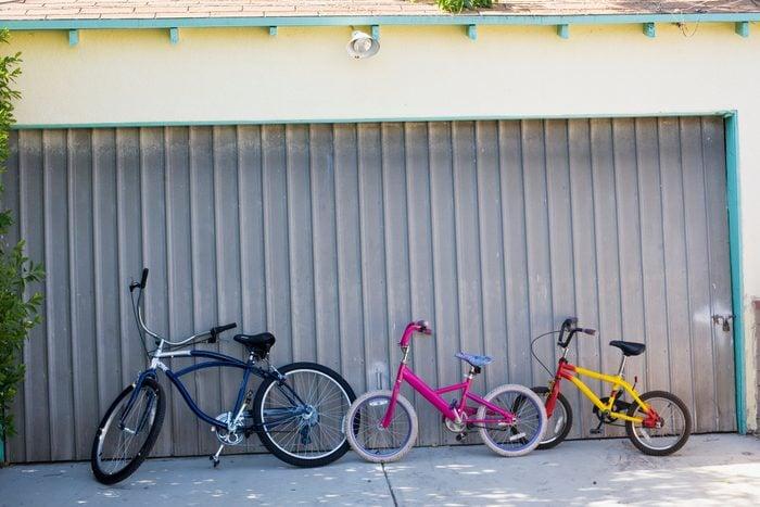 Bikes in front of a closed garage door