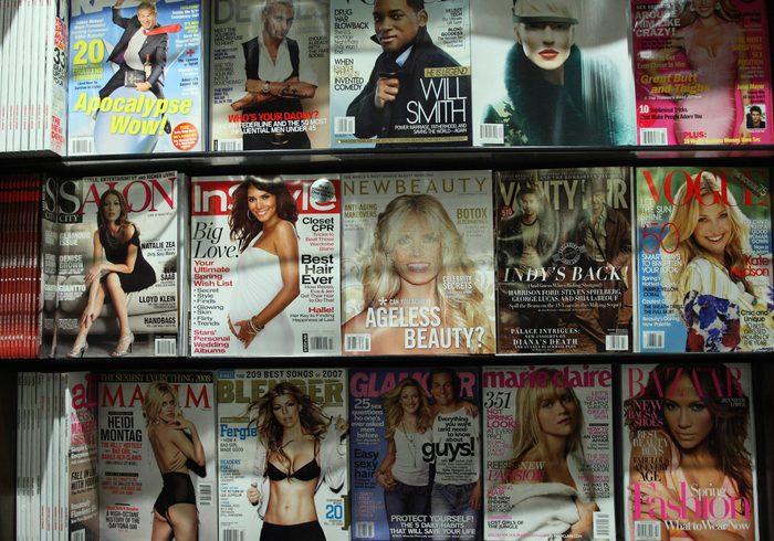 Fashion magazines displayed on shelves