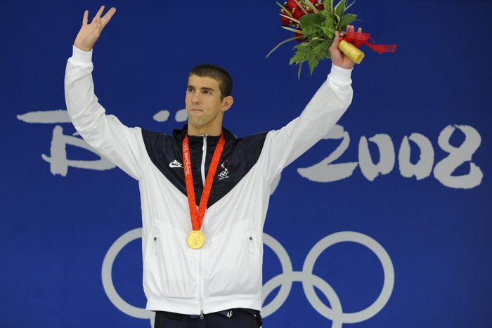 US swimmer Michael Phelps stands on the