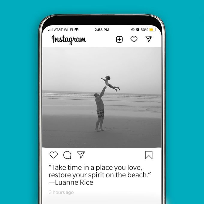 instagram screenshot displaying picture of two people playing at the beach in black and white