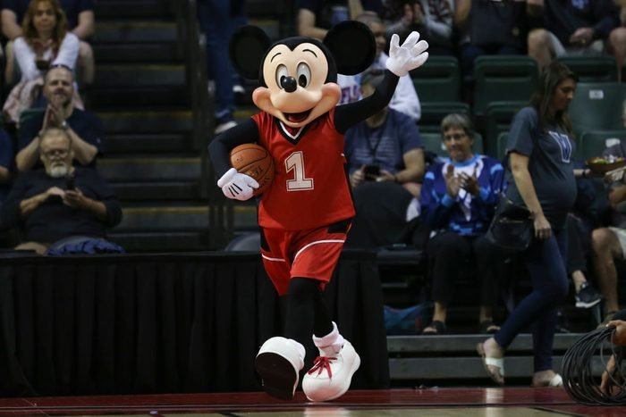 Mikey Mouse playing basketball
