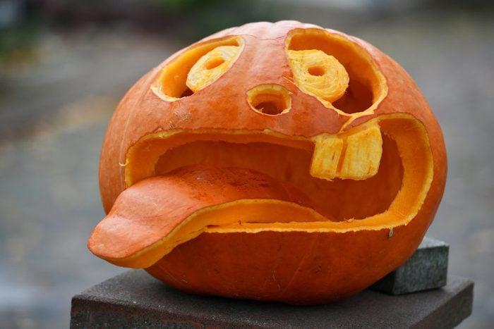 goofy face carved into a halloween pumpkin