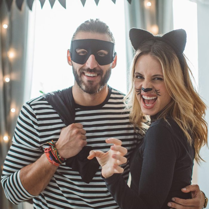 couple dressed in Cat burglar Halloween costume at a party