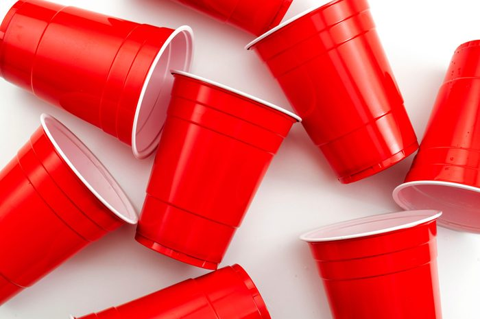red solo cups scattered on white background