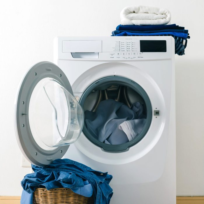 Washing Machine And Cloth In Basket. Loudry Concept