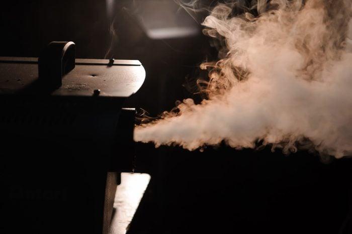 fog machine in dark room