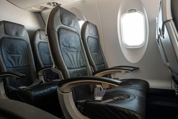 Empty airplane seats in second class on an international flight during August peak season