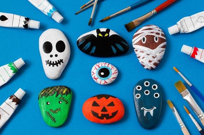rocks decorated as halloween characters and art kids craft; skull, bat, mummy, eye, frankenstein, pumpkin, monster