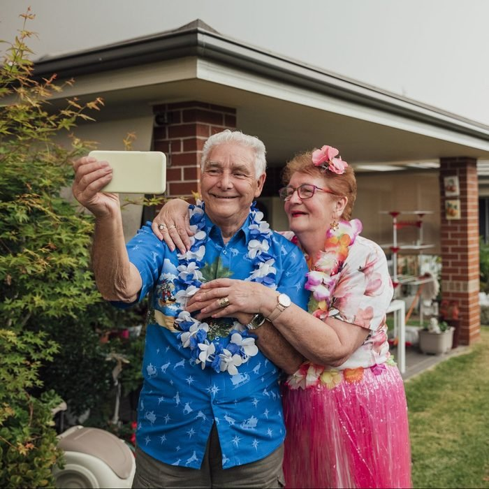 senior couple dressed as Tacky tourist for Halloween costume