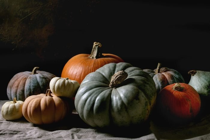 group of colorful pumpkins on dark background
