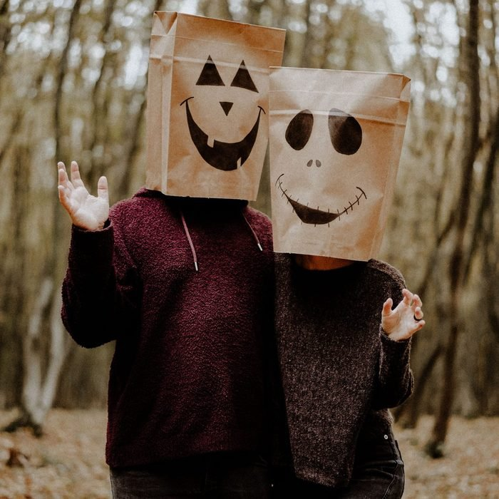 two people wearing Paper bag jack-o-lantern Halloween costume