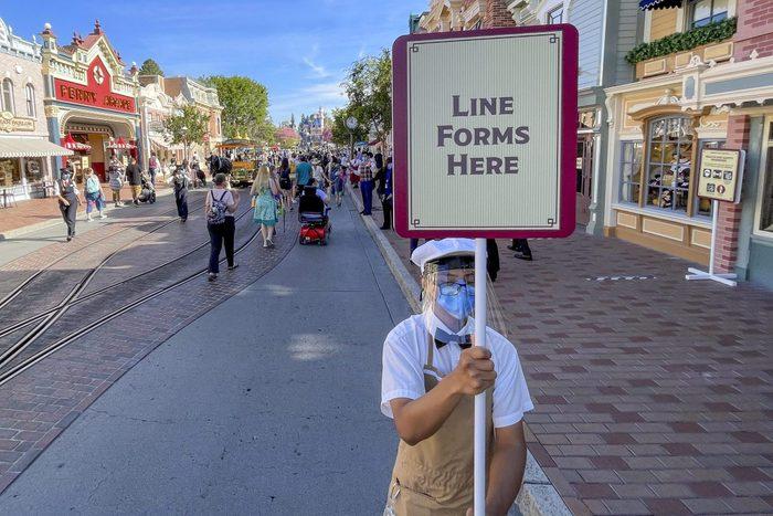 Disneyland employee wearing a facemark during reopening