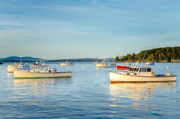 Fishing Boats Anchored in Calm Waters at Sunset