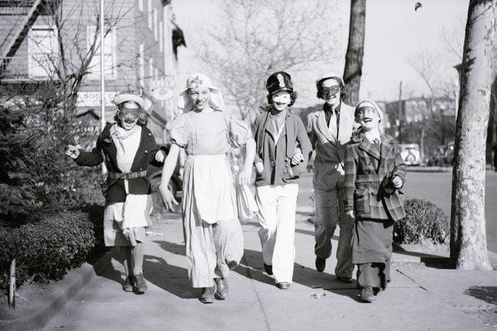 Children Dressed For Halloween walking down a sidewalk in jersey city, nj