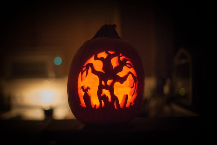 scary tree carved into a pumpkin