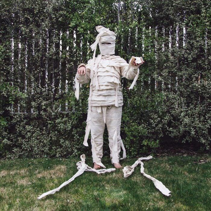 child dressed in mummy halloween costume