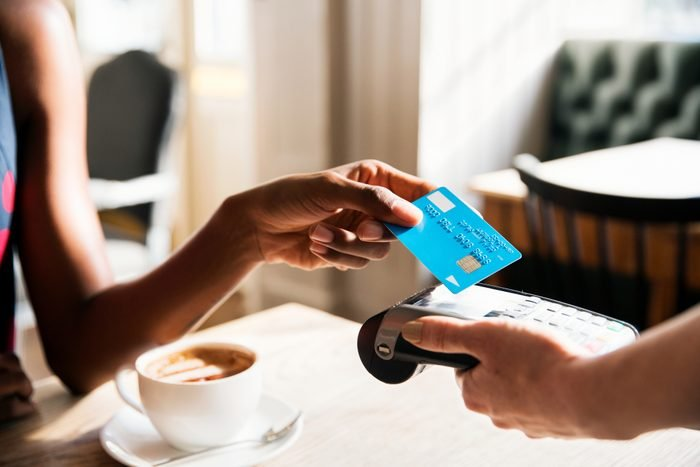 Woman using contactless payment with credit card