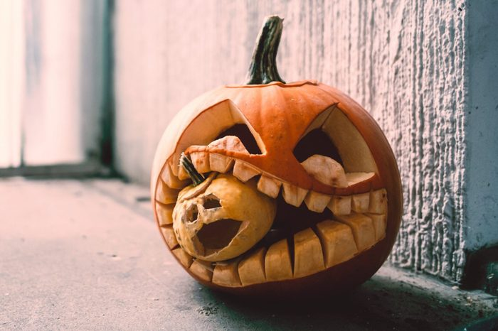 Close-Up Of Jack O Lantern On Window Sill During Halloween
