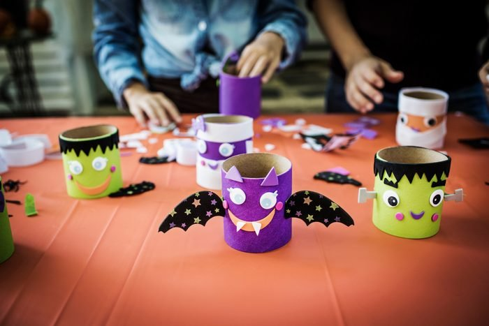 children making toilet paper roll monsters at a halloween party