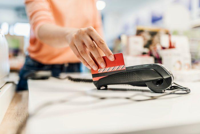 swiping credit card through machine