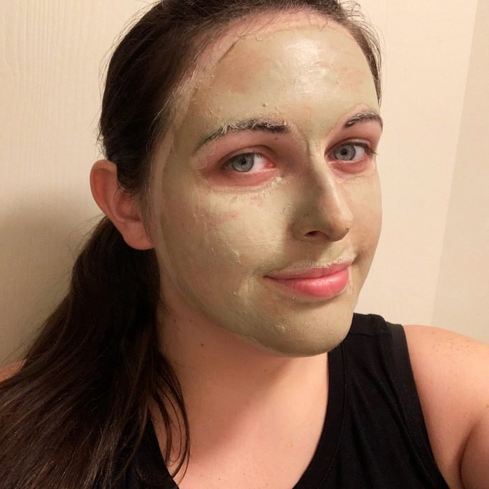 Selfie of Kelly Kuehn with aztec clay mask on face