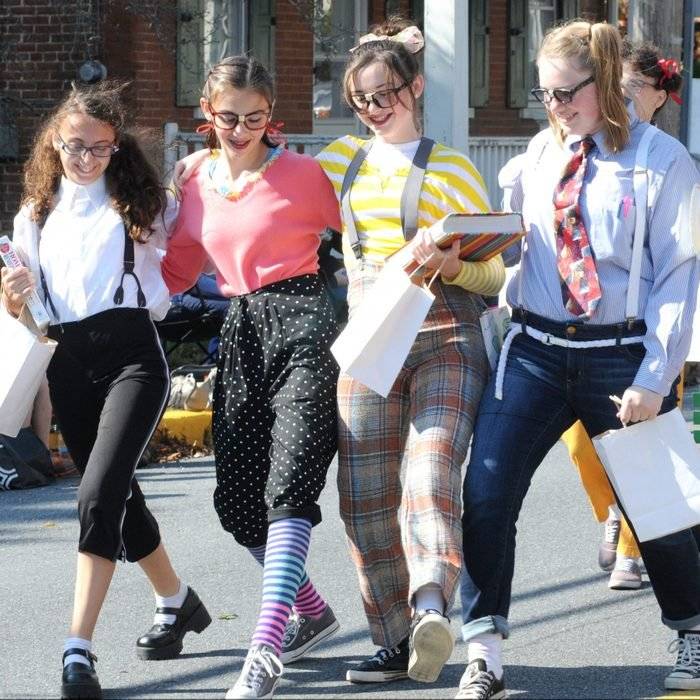 four young girls wearing nerd halloween costumes