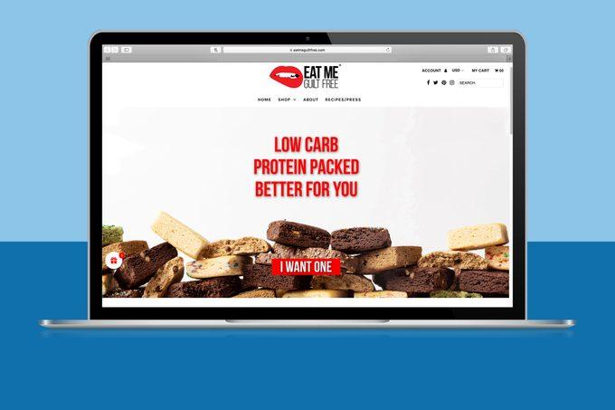 Eat Me Guilt Free website homepage on laptop screen
