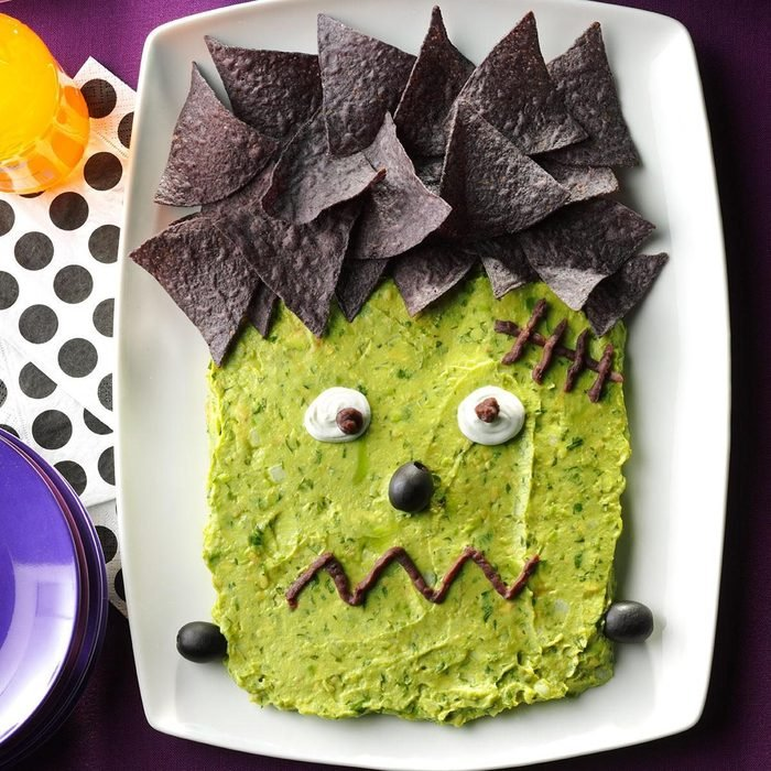 Frankenguac; guacamole and chips arranged to look like frankenstein's face for a halloween party dip idea