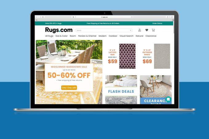 Rugs.com homepage on laptop screen