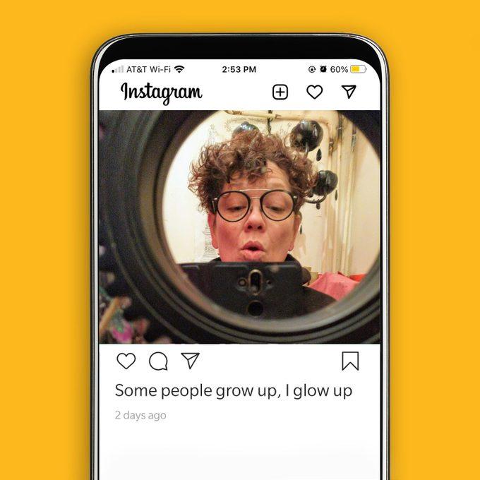 Woman takes mirror selfie in circular mirror