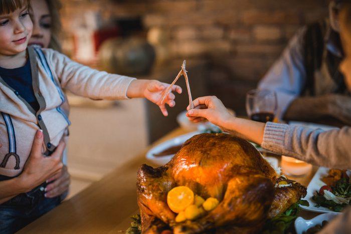 Pulling wishbone on Thanksgiving