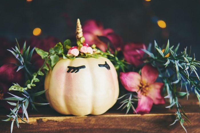 Handmade unicorn pumpkin with flowers and leaves