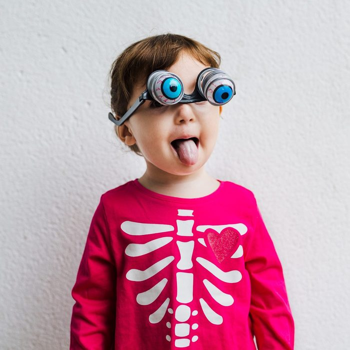 toddler dressed as a silly skeleton for halloween
