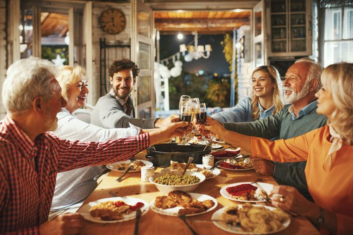 Family and friends having thanksgiving toast at dinner table