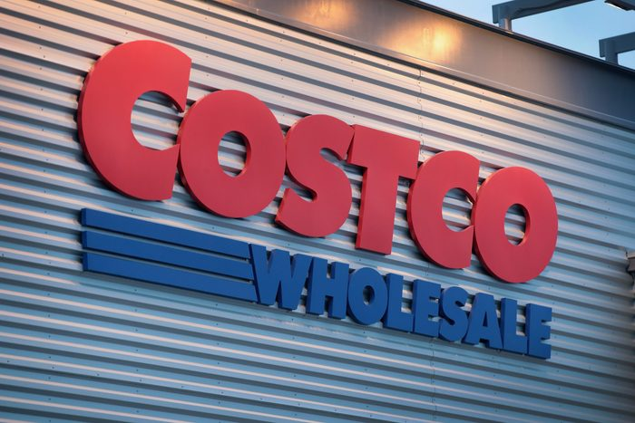 close up of costco wholesale sign on exterior of building