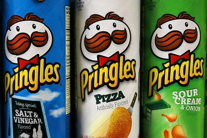 Three Pringles cans with Pringles logo