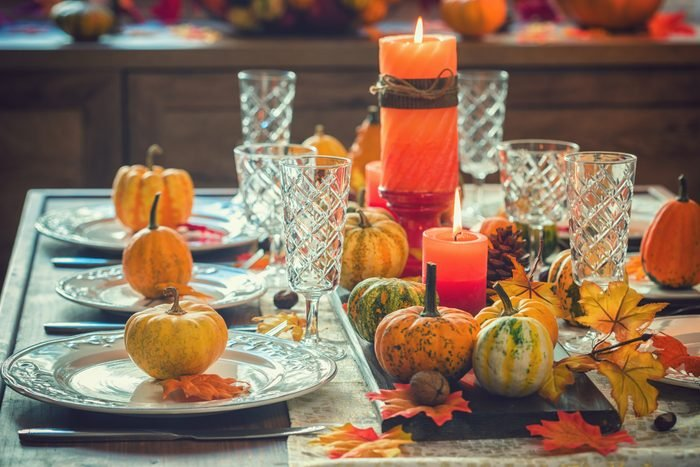 Thanksgiving Dining Table Place Setting with Autumn Decoration