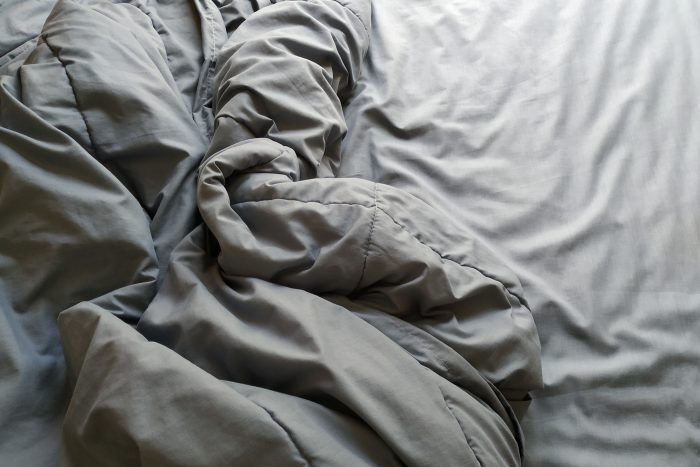High Angle View Of Crumpled Blanket On Bed At Home