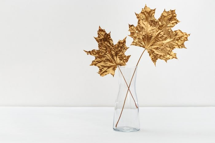 Gold painted leaves in glass