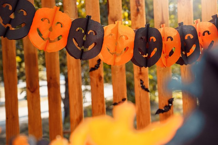 Paper garland decoration for halloween on wooden fence