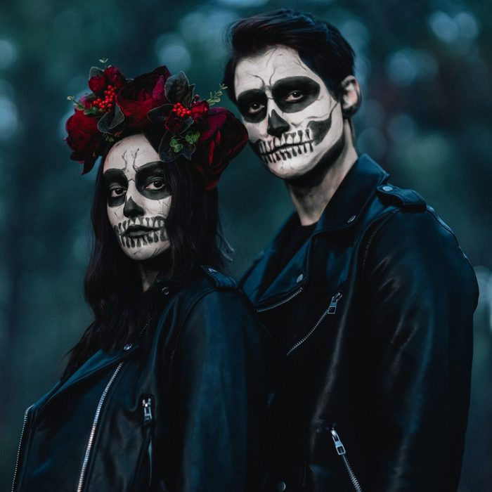 couple wearing day of the dead halloween costume