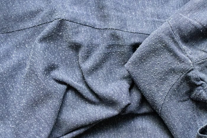 close up of pilling on gray sweater